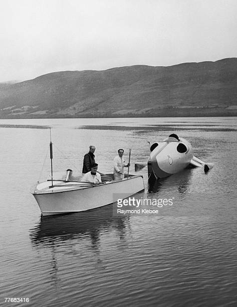 Engineers George Bristow of De Havilland and Hugh Jones of Vospers towing the jet powered speed boat 'Crusader' on Loch Ness Scotland during an...