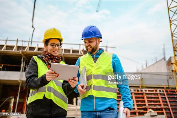engineers having meeting regarding new construction phase - control stock pictures, royalty-free photos & images