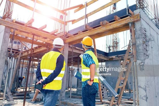 Engineers having meeting regarding new construction phase