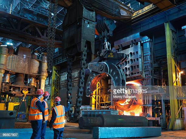 engineers & hot steel in forging machine - steelmaking stock photos and pictures