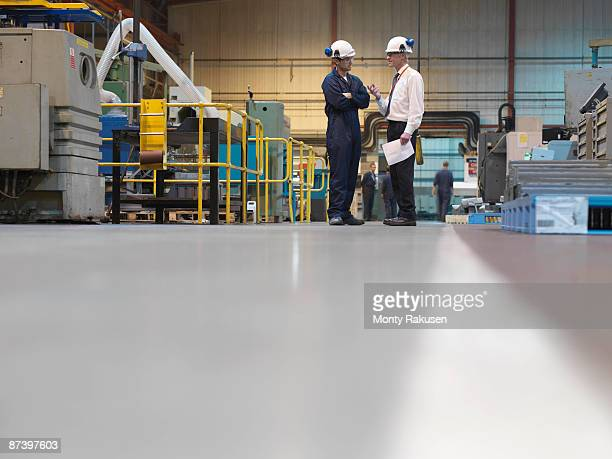 engineers in factory - foreman stock pictures, royalty-free photos & images