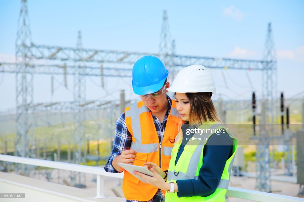 Engineers in front of power station : Stock Photo
