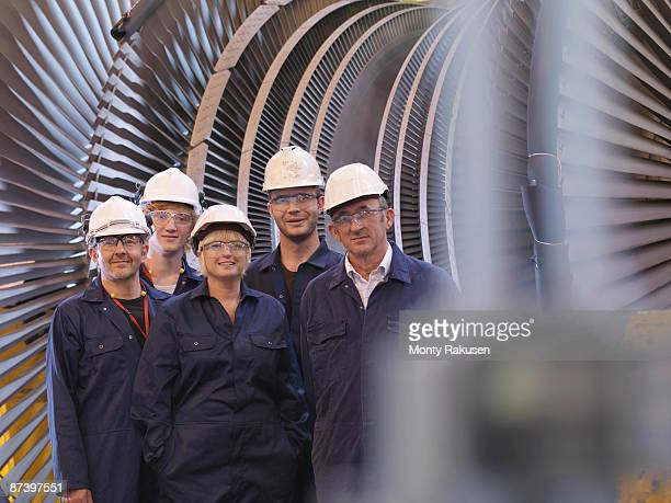 Engineers In Front Of Turbine