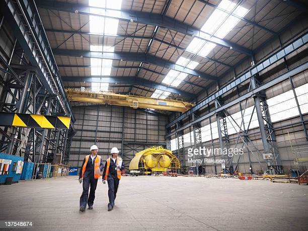 engineers in shipping yard - shipyard stock pictures, royalty-free photos & images