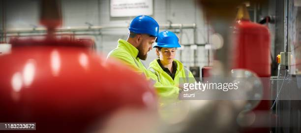 engineers in turbine room - water pump stock pictures, royalty-free photos & images