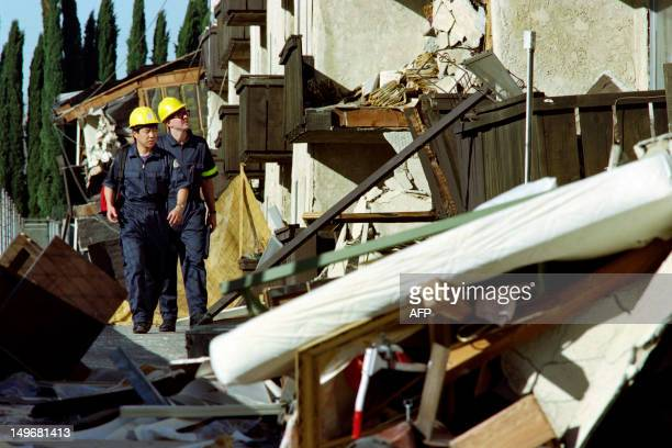 Engineers inspect one of the buildings at the Northridge Meadows Apartments early on january 18 1994 in one of the area hardest hit by the January 17...