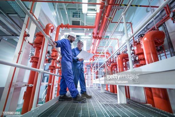 engineers inspecting fire safety equipment in a nuclear power station. - atomic imagery stock pictures, royalty-free photos & images
