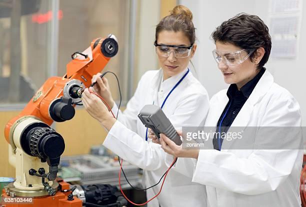 Engineers inspecting machine