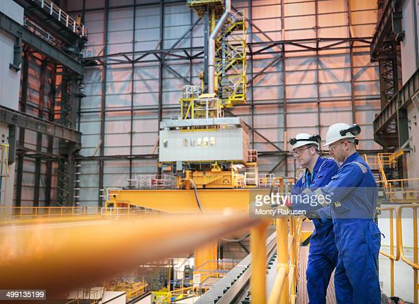 Engineers inspecting reactor hall in nuclear power station