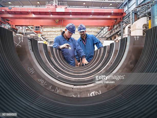 Engineers inspecting turbine housing during power station outage