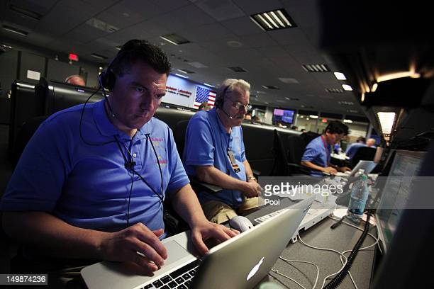 Engineers Kyran Owen-Mankovich , and Brad Compton work inside the Spaceflight Operations Facility prior to the landing of NASA's Mars Science...