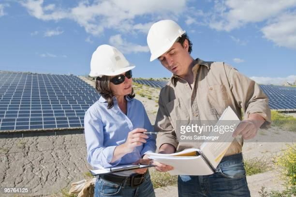 engineers looking at plans in solar plant