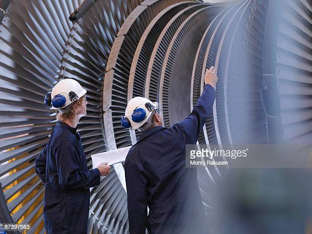 engineers looking at turbine - engineering stock pictures, royalty-free photos & images