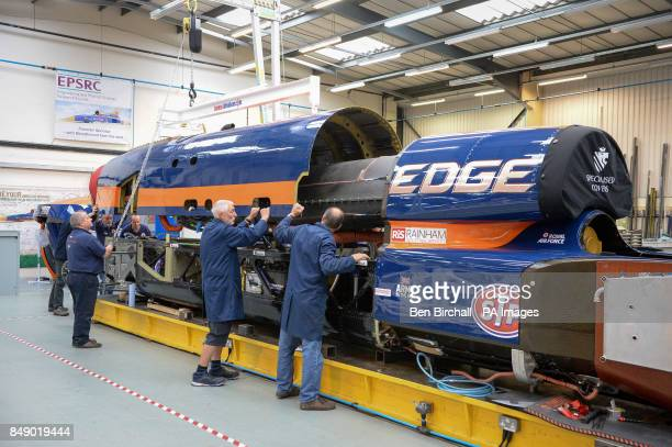 Engineers move the upper chassis which houses the jet engine on a gantry for mounting to the lower chassis at the Bloodhound Technical Centre in...