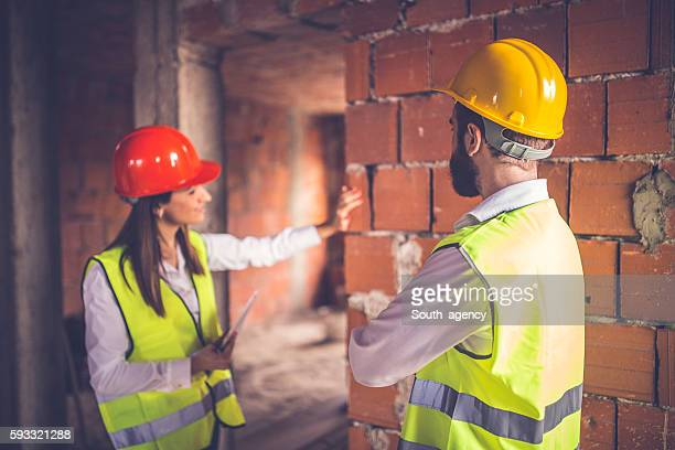 engineers observing construction site - safety american football player stock pictures, royalty-free photos & images