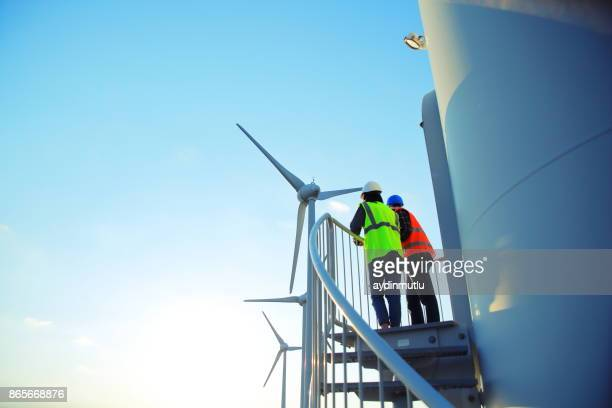 engineers of wind turbine - windmills stock photos and pictures