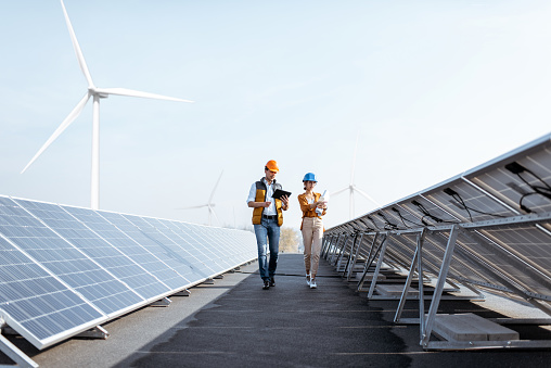 Engineers on a solar power plant 1188930630