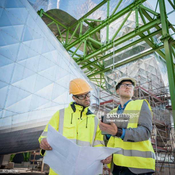 engineers on modern power station construction site