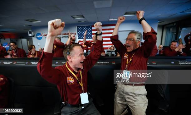 TOPSHOT NASA engineers on the flight team Kris Bruvold and Sandy Krasner celebrate the InSight spacecraft's successful landing on the planet Mars...
