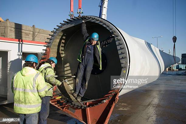 Engineers on the ground working on the last remaining 11ton blade on a 25 megawatt wind turbine at Alexandra Dock in Liverpool The three 45meter...