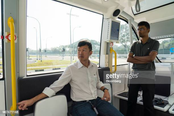 Engineers ride a Navya SAS autonomous electric passenger bus travelling along the test circuit at the Centre of Excellence for Testing Research of...