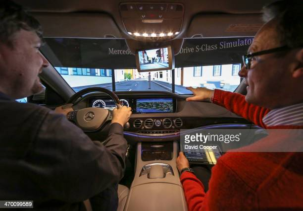 TORONTO ON FEBRUARY 14 Engineers Rolf Magnus and Matthias Struck put the MercedesBenz Simulator Intelligent Drive SClass Simulator through it's paces...