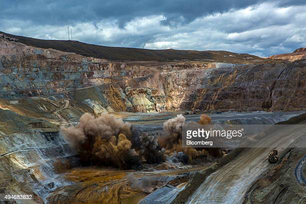 Engineers set off explosions in order to remove soil while mining for gold in a pit at the Yanacocha gold mine in Cajamarca Peru on Thursday Oct 22...