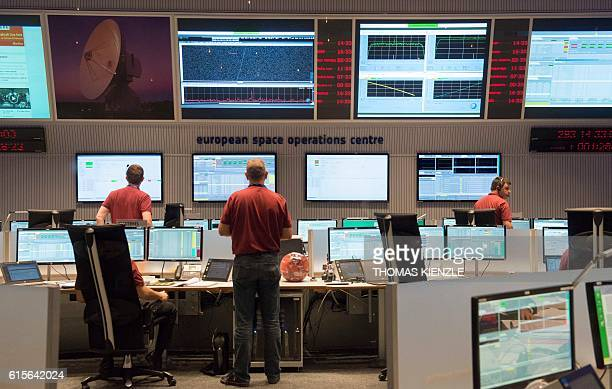 Engineers stand in the main control room of the European Space Agency prior to the expected landing of the decent modul Schiaparelli of...