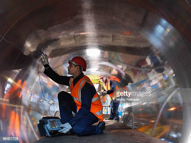 engineers testing forged steel - helmet stock pictures, royalty-free photos & images