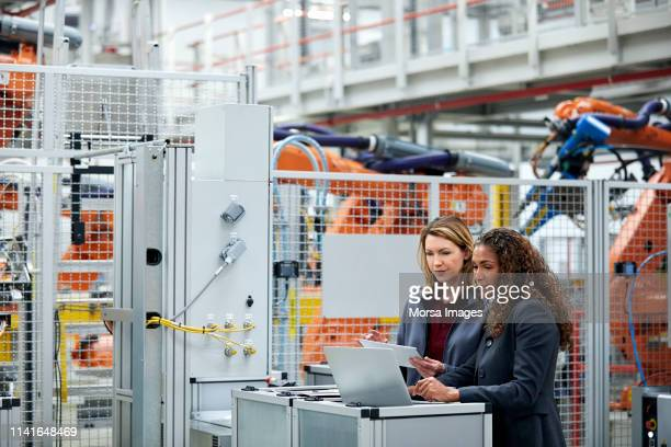 engineers using technologies in auto industry - automated stock pictures, royalty-free photos & images