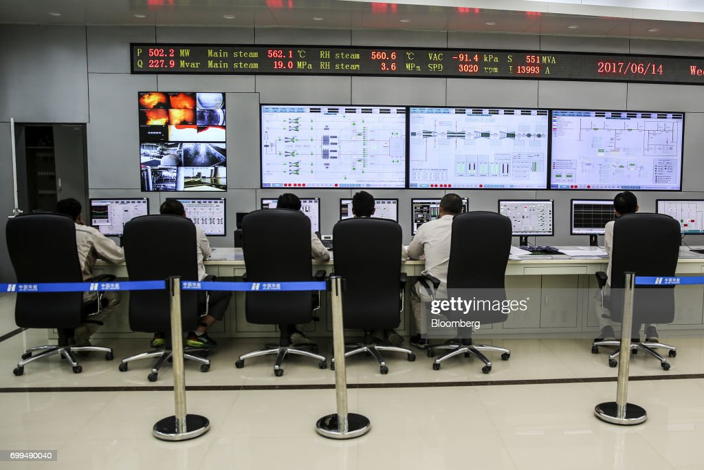 Engineers work in a control room at the Sahiwal coal power plant owned by China`s stateowned Huaneng Shandong Rui Group in Sahiwal Punjab Pakistan on.