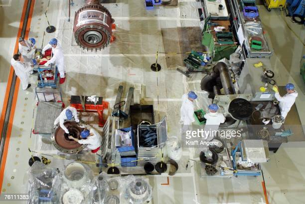 Engineers work in the turbines hall during a routine inspection at the nuclear power plant on August 15 2007 in Kruemmel near Geesthacht about 30 km...
