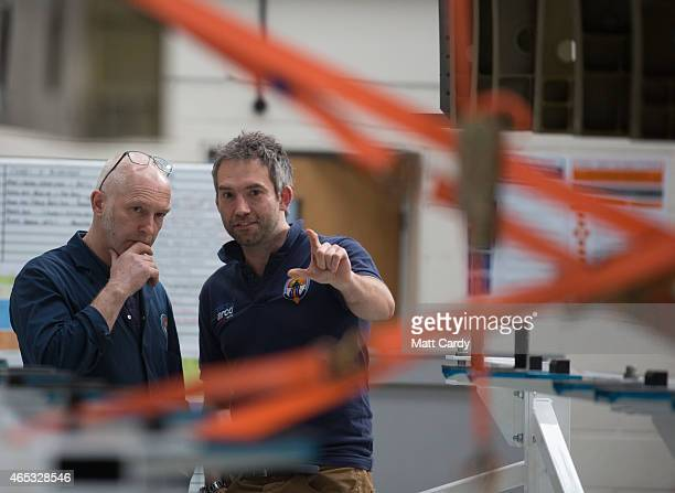 Engineers work on a body panel of the Bloodhound SSC vehicle currently taking shape at its design centre in Avonmouth on March 5 2015 in Bristol...