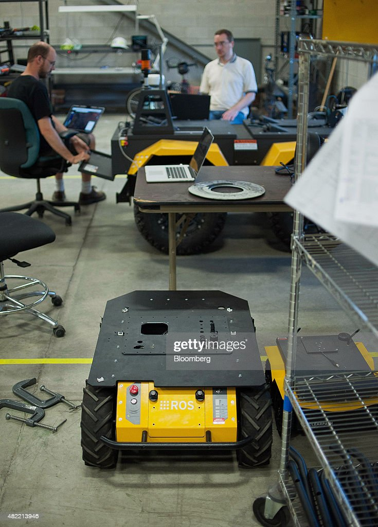 Engineers work on Grizzly, the company's largest robot, at the Clearpath Robotics Inc. facility in Kitchener, Ontario, Canada, on Friday, July 24, 2015. Clearpath Robotics, Inc. manufactures industrial robot research and development applications in addition to offering guidance, navigation, control, perception, military engineers, educational mobile robots, hardware components, and computer scientists. Photographer: James MacDonald/Bloomberg via Getty Images