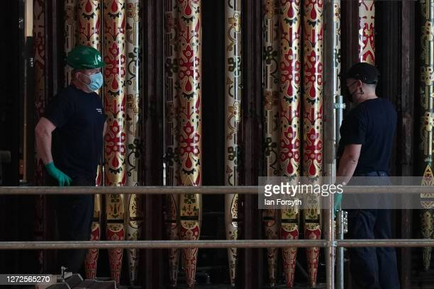Engineers work on newly restored pipes for the York Minster organ following refurbishment on September 15, 2020 in York, England. The...