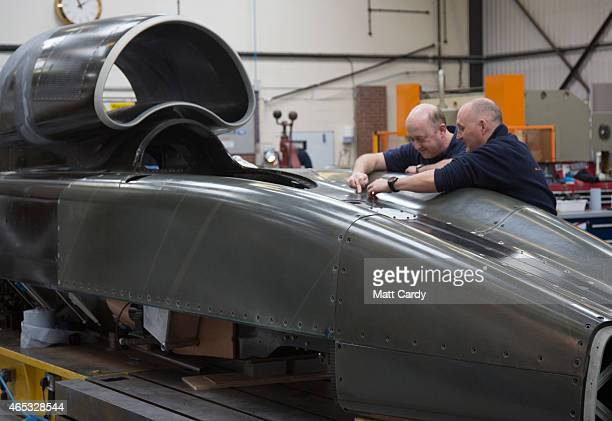 Engineers work on the carbonfibre body of the Bloodhound SSC vehicle currently taking shape at its design centre in Avonmouth on March 5 2015 in...