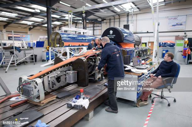 Engineers work on the lower chassis in preparation for mounting the upper chassis which houses the jet engine at the Bloodhound Technical Centre in...