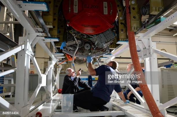 Engineers work on the upper chassis which houses the jet engine in preparation for mounting it to the lower chassis at the Bloodhound Technical...