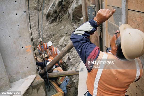 Engineers working at Big Creek bridge, elevated view