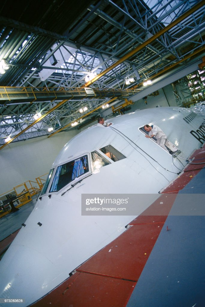 engineers working on a British Airways Boeing 747-400 in a