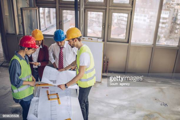 Engineers working on construction site