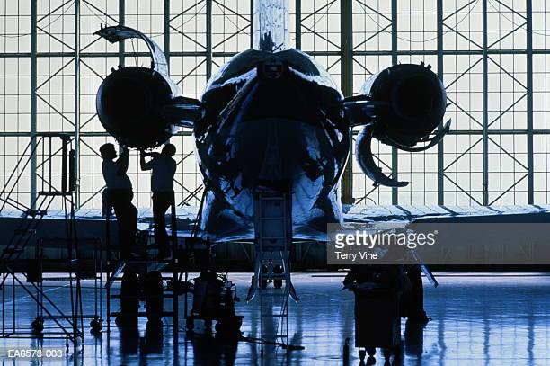 engineers working on passenger aircraft engine, rear view - 航空宇宙産業 ストックフォトと画像