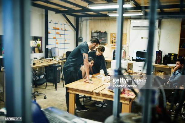 engineers working on project in design studio - design studio stock pictures, royalty-free photos & images
