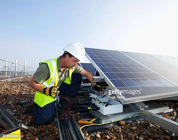 engineers working on solar panels - hugh sitton stock pictures, royalty-free photos & images