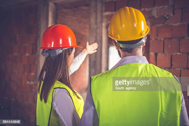 engineers working - safety american football player stock pictures, royalty-free photos & images