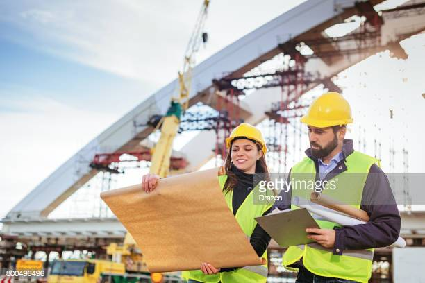 Engineers working together on construction site before the deadlines
