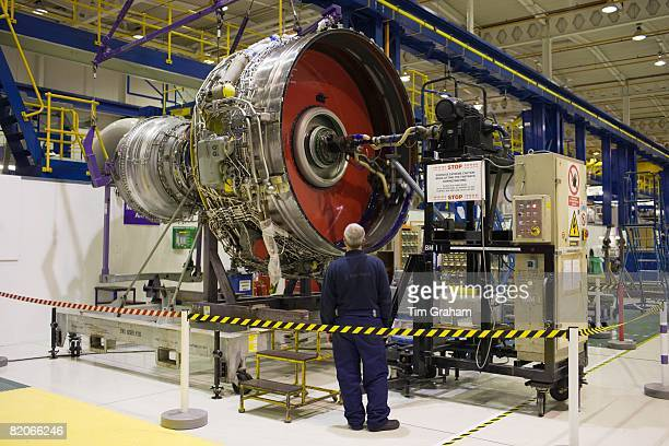 Enginer works on a Rolls Royce jet engine in the production factory Derbyshire United Kingdom