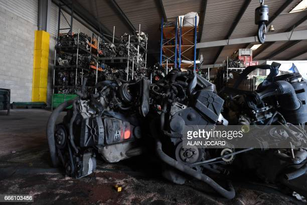 Engines are stored at the Indra Automobile Recycling centre in PruniersenSologne near Blois central France on April 7 2017 / AFP PHOTO / ALAIN JOCARD