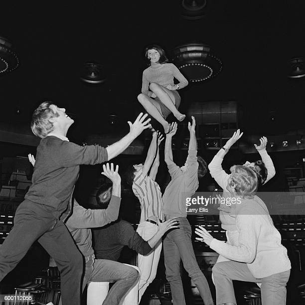 Engish pop singer Sandie Shaw rehearsing for a show at The Talk of the Town in London with the Dougie Squires Dancers UK 28th November 1967