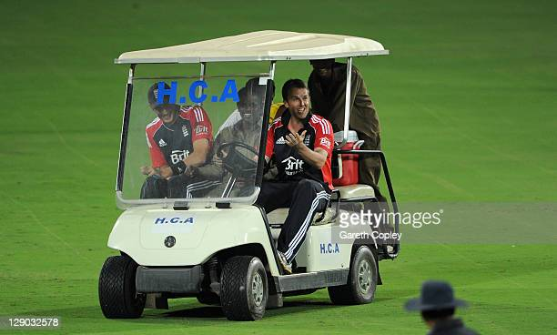 England 12th man Graeme Swann drives a golf buggy around the outfield during a drinks break during the tour match between England and Hyderabad...